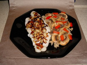Swai Almondine with brown rice topped with sauteed mushrooms and red pepper strips